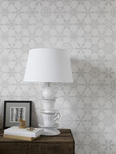 Wilson's Crystals Wallpaper by Abigail Edwards is an intricate hand-drawn design that features 30 different snowflakes, each one drawn individually and arranged in a graphic retro pattern.