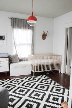 animal wall mount, diamond rug, modern light fixture