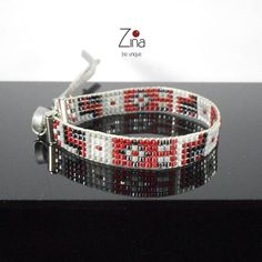 Woven in Delicas Miyuki Beads Bracelet Model - handmade unique Zina be original Colors: Gray Dark red Silver Gunmetal Black Composition: -Miyuki Delica 11/6 -Silver Clasp -Length 15cm - 3mm - black leather cord Length: 14cm adjustable to any wrist thanks to the leather cord. Width:
