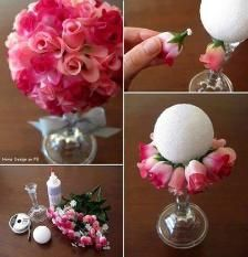Topiary using glass candlestick, foam ball and embellishments.  Would make a nice centerpiece with a low height for banquet tables.