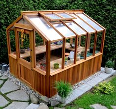 Freestanding wood frame greenhouse by CedarBuilt makes a great She-shed