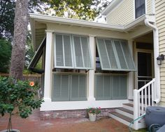 Porch Shutters...neighbor side only. Railings towards back yard.
