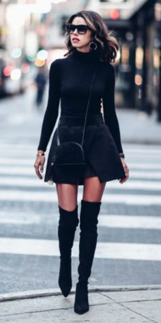 Annabelle Fleur + slitted A line mini skirt + thigh high boots + simple black turtleneck + monochrome street style + circular cross body bag + silver hoop earrings + shades.  Outfit: Nordstrom.
