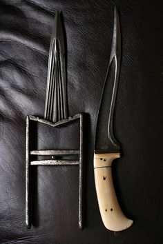 Sikh weapon. Left one Called kataar & right one called pesh baaj.