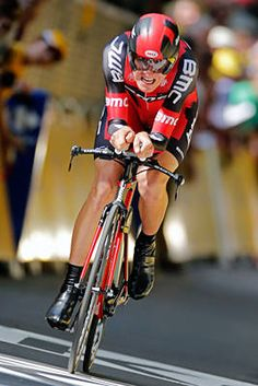 American Tejay van Garderen strains as he crosses the finish line to take fourth in the prologue, an individual time trial over 6.4 kilometers (4 miles) with its start and finish in Liege, Belgium, in the Tour de France.