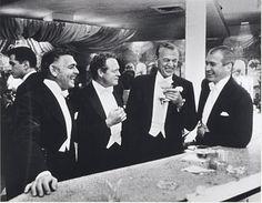 The Four Kingsof Holywood - Clark Gable, Van Heflin, Gary Cooper and Jimmy Stewart, 1957by Slim Aaron  Via