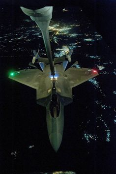Air Force has released images of its latest fighter jet on one of its first combat missions. An Raptor stealth jet - above - is seen being refu. Military Jets, Military Aircraft, Fighter Aircraft, Fighter Jets, Stealth Aircraft, Photo Avion, F22 Raptor, Night Photos, Pictures Of The Week