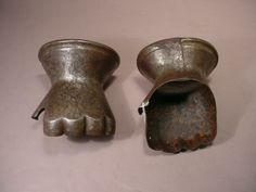 A pair of gauntlets in late 14th century style