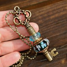 Add A Bead brass plated changeable Key Pendant with K O by koregon, $29.99