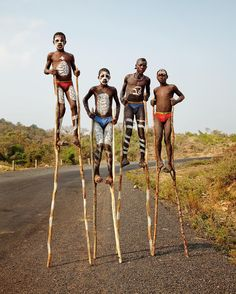 Part 4/5: The Omo Valley is a remote region of Ethiopia, bordering South Sudan and Kenya. We were among the only cars on the road during our drive into this area, known for the numerous tribal groups living an isolated existence. These boys were on stilts in the middle of the road, wearing elements of their traditional Bena tribal attire and westernized cotton briefs. I thought this was a creative way to make a few birr off the occasional tourist on the road. @jessicaantola stilts africa…