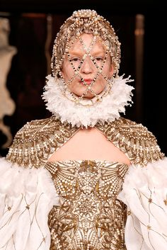 Alexander McQueen Fall 2013- In this image, there is a ruff or a Betsy around the model's neck. In the empire period, there was a wave of Renaissance influence and ruffs were popular embellishments on dresses.
