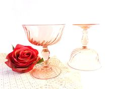 Pink depression glass set from Arcoroc France ! This set is called Rosaline Arcoroc Glass and was manufactured in the lates 60s. This vintage glassware set is perfect for a vintage wedding pink deco with a shabby chic twist ! The two glasses is obvioulsy pink and can be used for champagne coupe glasses or as a candle holder ! I have myself 2 cups of this style at home and I use it as a candle holder! I pour water and I put 2 floating candles inside! The result is magic ans very romantic…
