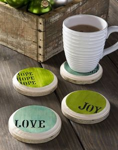 """Interesting idea: coasters. . . created using a wooden disk or plaque (4""""), mod podge, scrapbook paper, and stenciled letters."""