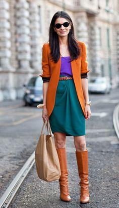 Teal skirt, purple shirt, orange blazer, tan boots, watch, red nail polish