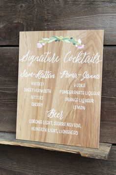 Stained plywood signature cocktail sign. Handpainted with watercolor florals to coordinate with wedding invitations