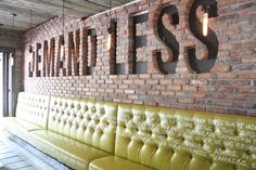 """Love the built-in banquette and the brick treatment. Not sure I would have chosen those words exactly. I would have written """"BE AMAZING"""""""