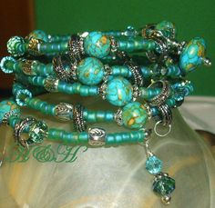 Memory Wire Bracelet Five Strand Bracelet. I like the loose ring over the beads.