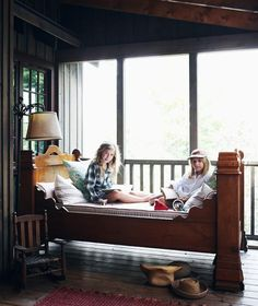 I LOVE the idea of putting a pretty bed on a screened porch.  Rain on a tin roof anyone?  Bliss.