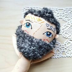 I finally got hold of just the right two types of yarn for this studs hairdo and removable beard Yes! He's a cool dude