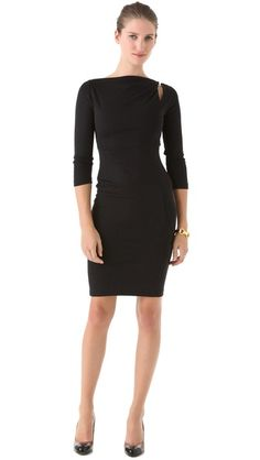 DSQUARED2 Jersey Dress    A curve-conforming sheath dress, rendered in soft jersey and accented with a polished logo clip at the cutout shoulder. The boat neckline folds into a gentle cowl, and fitted long sleeves complete the look. Unlined.  786.57 CAD