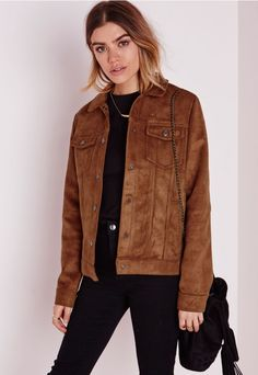 Cause a little chaos this season in this faux suede tan jacket. With fierce…