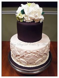 Two tier wedding cake with purple accents.