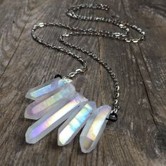 Over 200 beautiful and unique items to choose from including this stunning Angel Aura Quartz Crystal necklace! All jewelry comes in a hand decorated gift box!