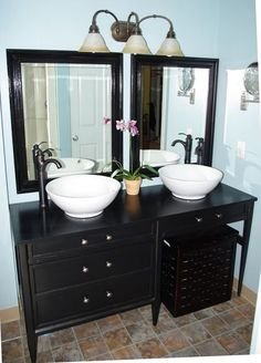 Desk used as bathroom vanity.  Love this idea.