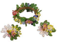 Very rare beaded flowers bracelet and earrings with glass beaded flowers and leaves, clip back earrings with Miriam Haskell horseshoe mark, circa 1960.