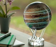 Ponder the great mysteries of the #universe while you space out at work with the spinning #Jupiter #globe. Designed with excruciating attention to detail, the globe slowly #rotates without having to physically touch it,