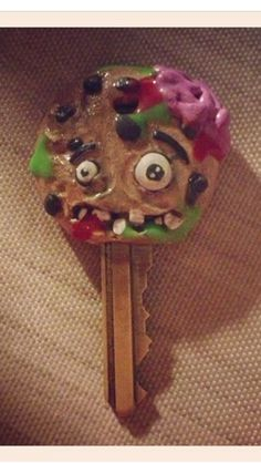 Zombie cookie key cap made from polymer clay.