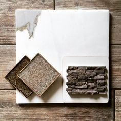 Quirky combo of calacatta marble, crackle-glass tile, mini-sculpted stone, and porcelain wood-look tile.