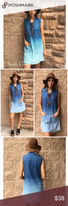 """Ombre Lace Up Dress Sleeveless denim dress featuring an ombre effect and lace up detailing. Collared & two available front pockets. Sizes S,M,L.                         Small  Bust 38 Length 35""""  Medium  Bust 40 Length 36""""  Large 42 Length 36"""" Dresses"""