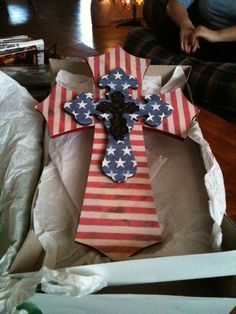 The wooden layered cross - painted and scrapbook paper'd that Dakota made me for Christmas this year. Christmas 2012