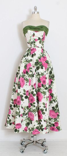 ➳ vintage 1950s dress * amazing magenta rose print gown * bright floral taffeta * moss green chiffon * acetate lining * strapless bodice with stays * back zipper closure * by Emma Domb condition | excellent - original zipper has been replaced fits like xs/s length 52 bodice 10 bust 36 waist 24-25 ➳ shop http://www.etsy.com/shop/millstreetvintage?ref=si_shop ➳ shop policies http://www.etsy.com/shop/millstreetvintage/policy twitter | ...