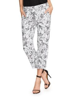 "GUESS Inbloom Sabrina Easy Cropped Pants GUESS. $98.00. 27"" inseam. silk. Women's pants. Cropped. Relaxed fit with tapered leg. zipper closure. Floral print"