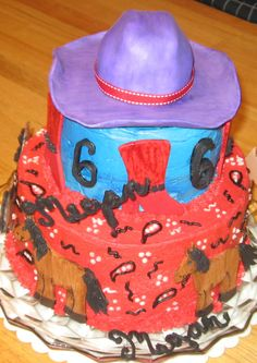 Cowgirl Birthday Cake.  Cowgirl stated she wanted a purple hat, a horse, boots, the number six and her name.