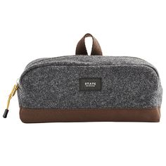 The Jay is a simple, yet sophisticated dopp kit. It features a stylish wool blend upper panel and rugged canvas bottom.