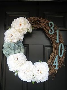 Love this idea of putting the house number on a wreath. Could replace the typical bow.