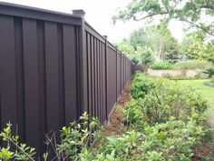 Dark brown composite fence material creates a natural backdrop for wooded properties Above Ground Pool Fence, In Ground Pools, Wood Edging, Garden Edging, Trex Fencing, Composite Fencing, Vinyl Fencing, Wood Composite, Fences