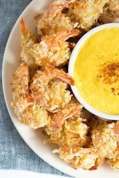 Coconut Shrimp with Mango Coconut Dipping Sauce is a fresh and flavorful appetizer or snack made with coconut flakes, fresh mango and more!