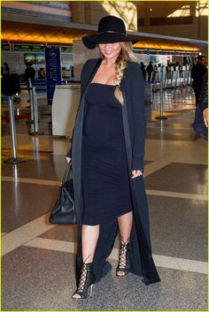 Chrissy Teigen Gives Middle Finger To Critics of Her Pregnancy