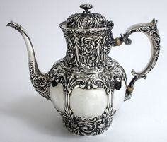 Whiting repousse decorated sterling silver coffee pot