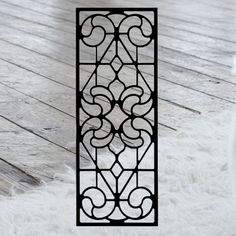 This decorative Wrought Iron Wall Art piece, Style 205,  features a Geometric rectangle silhouette that will add beauty and character to any wall or surface. It is coated in one of the most long-lasting finishes available - a flat black baked-on powder coated finish that will last for many years.