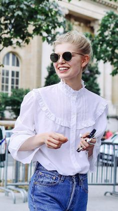 Ola Rudnika in a white prim Victoriana-style shirt paired with round sunglasses at the couture shows in Paris