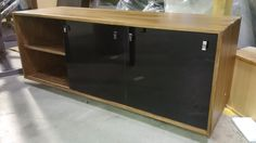 sliding door media cabinet - available in three sizes with sliding doors - doors are in a gloss polymer and come in 8 different colours - mid century modern
