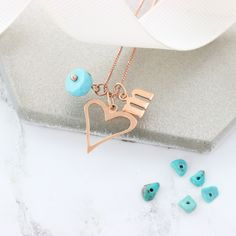 A personalised rose gold turquoise birthstone heart necklace with initial charms and birthstone gemstones to create a unique keepsake gift for her to treasure. Birthstone Charms, Birthstone Necklace, Turquoise Birthstone, Turquoise Jewellery, December Birthday, Letter Charms, Initial Charm, Initial Necklace, Birthstones
