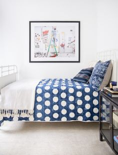 Blue and white bedroom with fabulous #pattern mixing, bold polka dots, and whimsical art. #home_decor #decorating