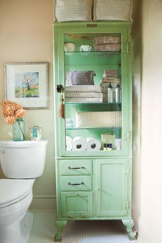 Organize with Vintage Pieces - 65 Calming Bathroom Retreats - Southernliving. If built-ins aren't possible, add storage and style with an antique cabinet. This homeowner stores towels and toiletries in a green vintage dental cabinet. See More of this Vintage-Style Home