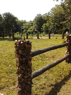Rock posts with rail fence